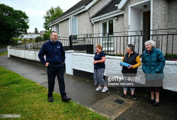 Wexford Ireland 17 June 2020 Professional boxer and member of An Garda Síochána Niall Kennedy speaks with residents of Crinion Park during a PPE...