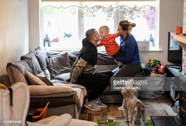 Wexford Ireland 17 June 2020 Professional boxer and member of An Garda Síochána Niall Kennedy with his wife Niamh and son MJ at their home in Gorey...