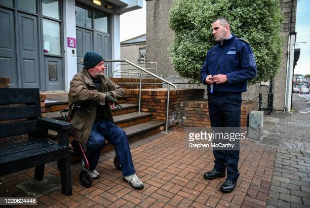 Wexford Ireland 17 June 2020 Professional boxer and member of An Garda Síochána Niall Kennedy has a friendly conversation with local resident Paul...