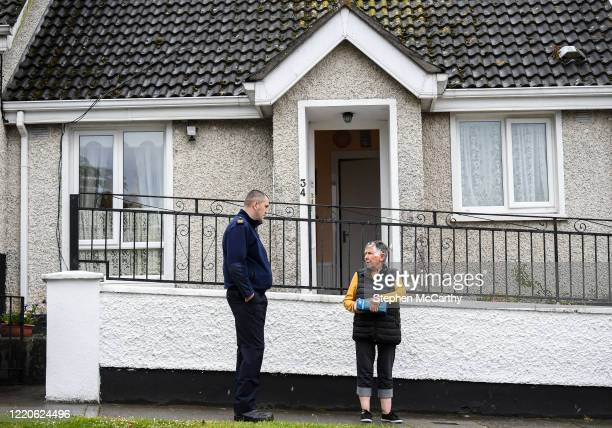 Wexford Ireland 17 June 2020 Professional boxer and member of An Garda Síochána Niall Kennedy speaks with Crinion Park resident Pixie Beamish during...