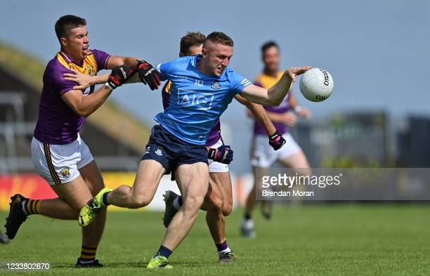 Wexford , Ireland - 4 July 2021; Paddy Small of Dublin in action against Brian Malone and Eoin Porter of Wexford during the Leinster GAA Football...