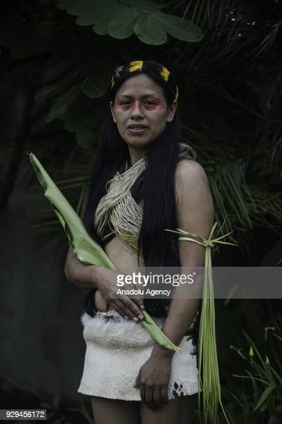 Weya Cahuila from Waorani tribe of Amazonian attends a ceremony to commemorate the International Day of Women in Puyo Ecuador on March 8 2018