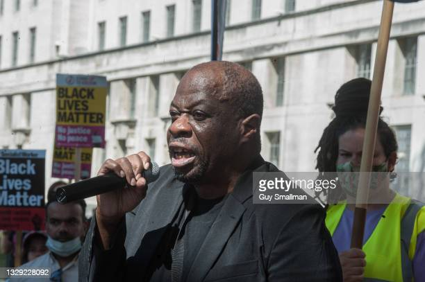 Weyman Bennet addresses the protest as supporters of Stand Up To Racism take the knee at Downing street to support black England players racially...