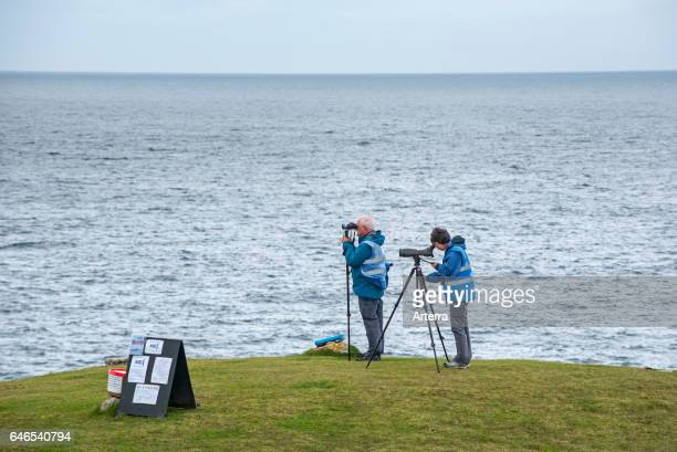 Whale and dolphin watchers looking for marine wildlife at Stoer Head / Stoerhead Sutherland Scottish Highlands Scotland