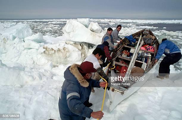 whalers launching boat into icy bering sea - bering sea stockfoto's en -beelden