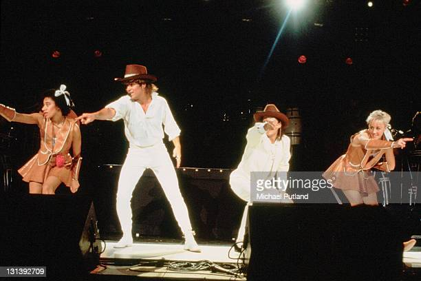 Wham! perform on stage with Pepsi and Shirlie at Sydney Entertainment Centre, Sydney, Australia, 27th January 1985, L-R L-R Helen 'Pepsi' DeMacque,...