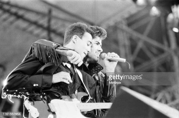 Wham, The Farewell Concert at Wembley Stadium, London England George Michael and Andrew Ridgeley on stage. 28th June 1986.