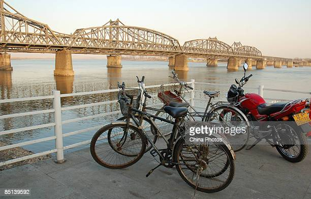 Wharf is seen in front of one of the destroyed bridges that once linked China and North Korea on February 27, 2009 in Dandong of Liaoning Province,...