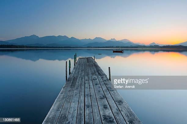 Wharf on Hopfensee lake in the evening light, Allgaeu, Bavaria, Germany, Europe