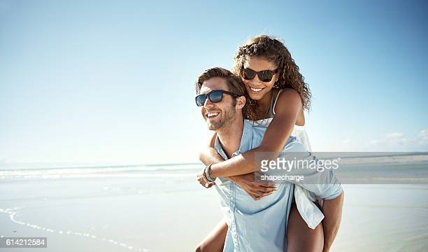 what a beautiful place to be in love - piggyback stock pictures, royalty-free photos & images