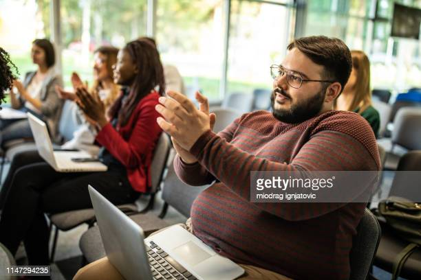what a great speech - fat woman sitting on man stock pictures, royalty-free photos & images