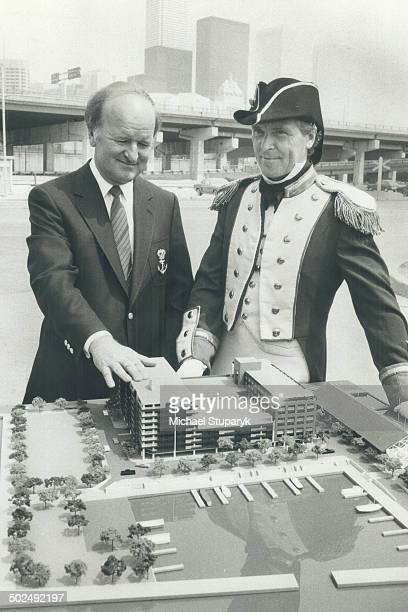 What a parking lot Walter Oster one of the owners of the proposed new Admiral Hotel and Admiralty Point condominiums and costumed Ernie Ryles eye a...