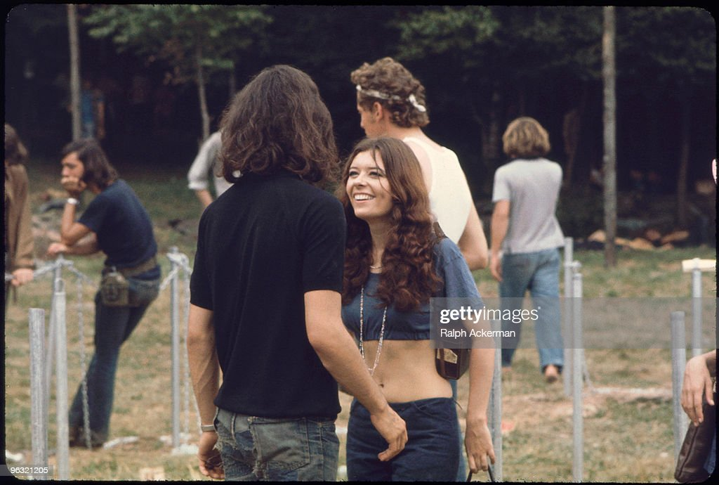 Young woman smiles up at young man : News Photo