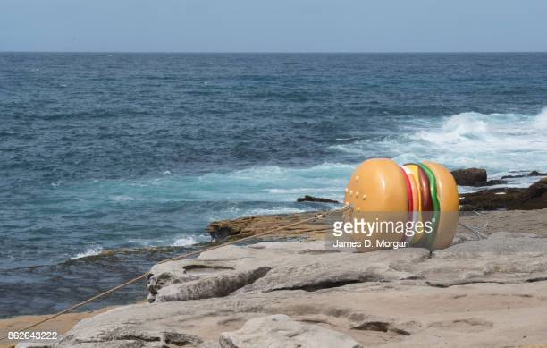 'What a Tasty Looking Burger' by James Dive at Sculpture By The Sea on October 18 2017 in Sydney Australia The annual art event draws tens of...