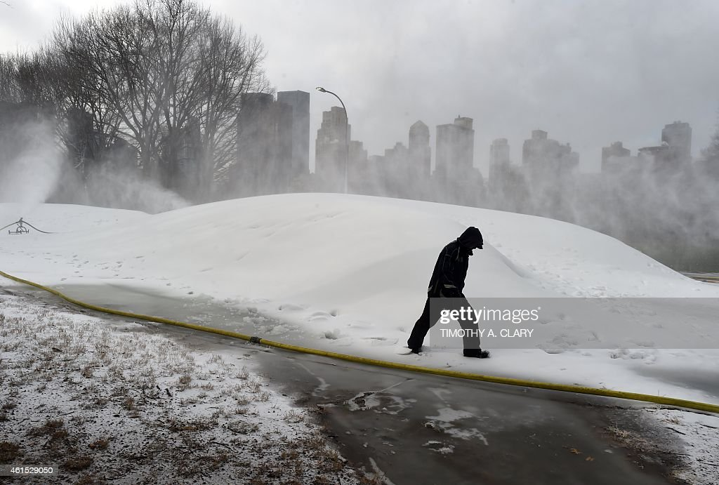 What appears to be a huge snowstorm in Central Park in New York on January 14, 2015, is actually workers making hills of artificial snow in preparation for the annual Winter Jam. The Winter Jam, to be held January 24, 2015 is the ultimate snow day, a free winter sports festival for New Yorkers of all ages, where you can go skiing, snowshoeing, shop in a winter market, and sledding in fresh snow, right in the heart of New York City.