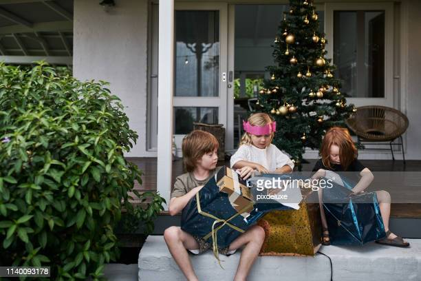 what did they get for christmas? - christmas tree stock pictures, royalty-free photos & images