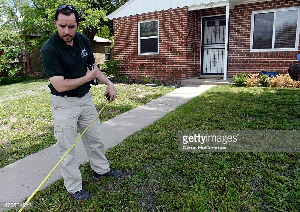 What do you do with a yard that is overrun with dandelions Marko Mackovic owner of Highlands Landscaping measures the front lawn as he talks about...