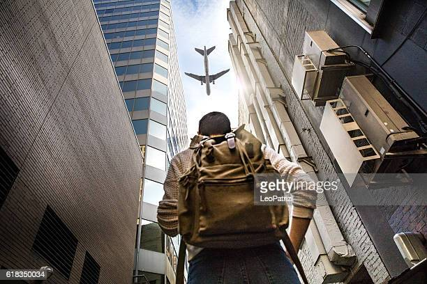 What is your next travel destination? Woman looking a plane