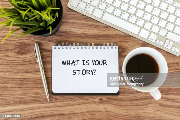 what is your story text on note pad - 読み聞かせ ストックフォトと画像