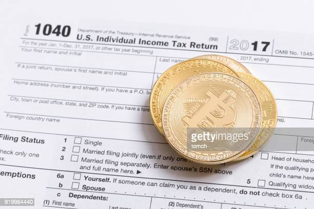 what kind of income does the purchased bitcoins belong to? - 1040 tax form stock photos and pictures