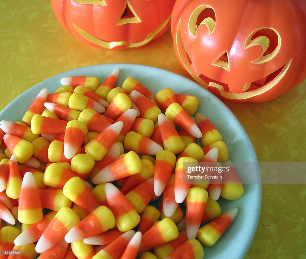 what makes a pumpkin smile? candy corn : Stock Photo