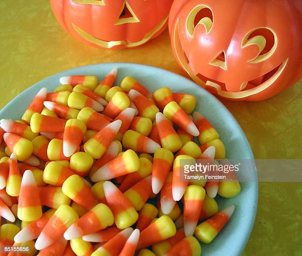 what makes a pumpkin smile? candy corn - halloween candy stock photos and pictures