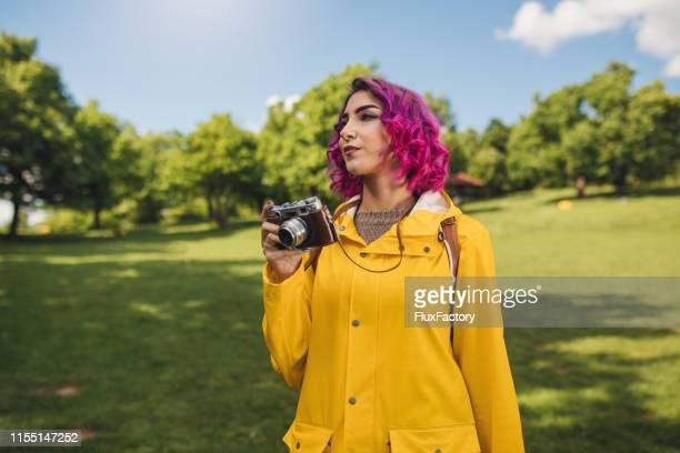 what shall i shoot next? - purple hair stock pictures, royalty-free photos & images