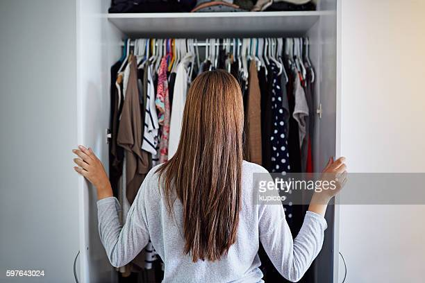 what to wear tonight? - kleding stockfoto's en -beelden