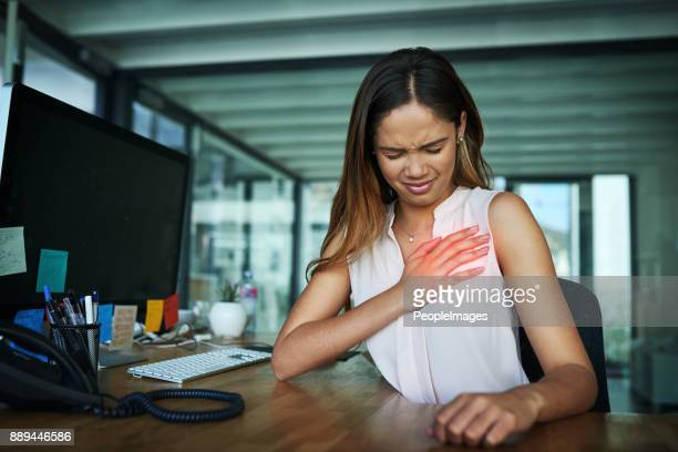 what was that sharp pain? - heartburn stock photos and pictures