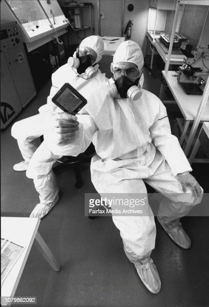 What welldressed hygienically sealed researchers wear in Macquarie University's 'clean room'special suits with dustless gloves masks and overshoesOne...