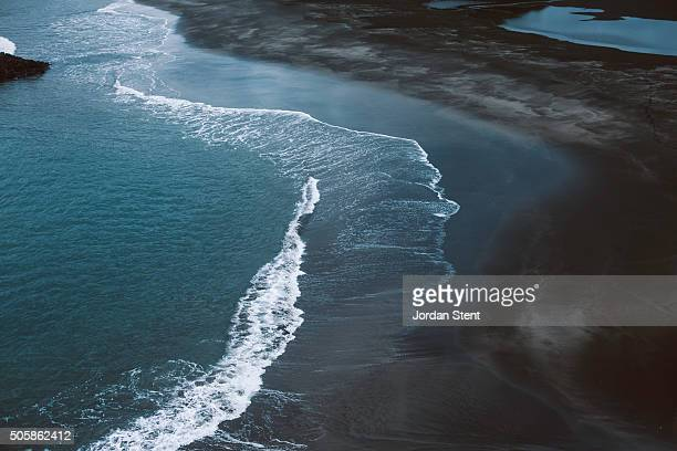 whatipu beach waves - stent stock photos and pictures