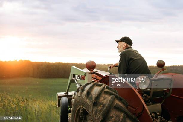what's a farmer without his tractor? - tractor stock pictures, royalty-free photos & images