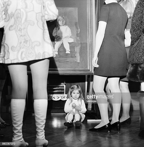 What's it all about Little Justine Hornby just sits as visitors to the Painters Hall look at her portrait December 1969 Z11504004