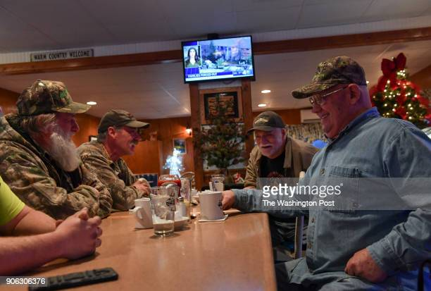 What's known jokingly as the 'Liars Table' at the KacKaPon Restaurant locals like Isaac Kohne left not pictured Gary Dalton second left Colin Perry...