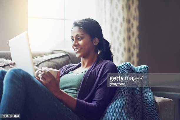 what's not to love about a lazy weekend indoors? - indian woman stock photos and pictures