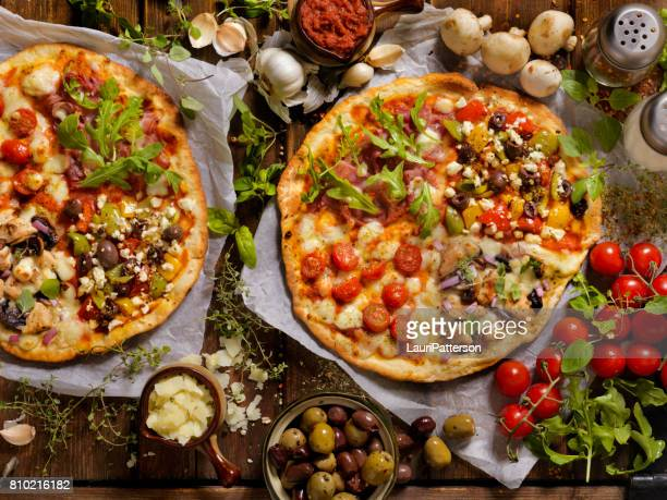 what's on your artisan pizza? - artisanal food and drink stock pictures, royalty-free photos & images