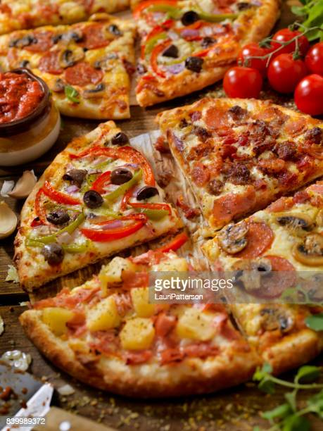 what's on your pizza? - pizzeria stock photos and pictures