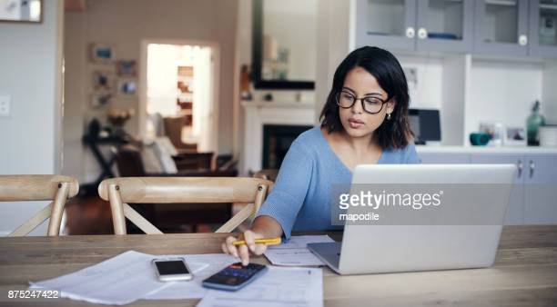 what's the budget looking like this month? - calculator stock photos and pictures