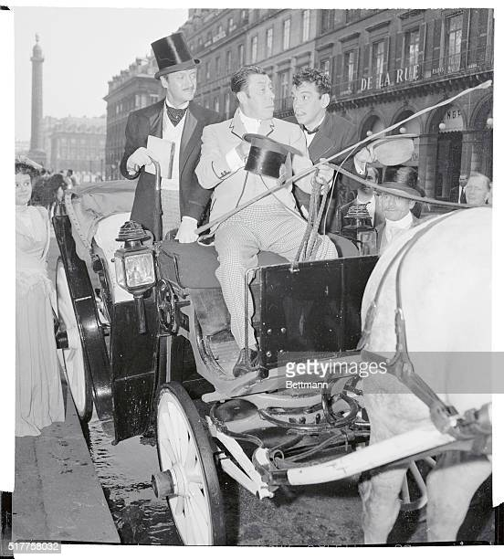 What's the hurry David Niven in the role of Phineas Fogg and Mexico's top comedian Cantinflas playing Passepartout try to spur on 'hack driver'...
