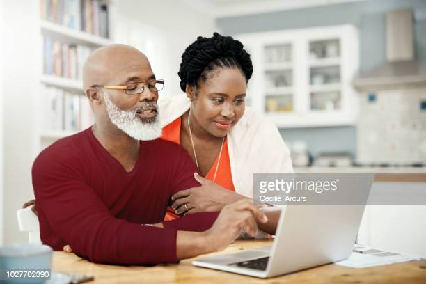 what's up in the world of the web? - african american couple stock pictures, royalty-free photos & images