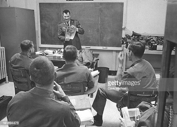 JAN 1967 FEB 7 1967 'What's wrong with this print' Staff Sgt Neal Ward is asking his photography class at Lowry Air Force Base The school at Lowry is...