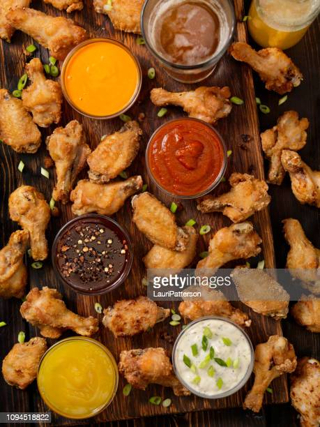 whats your favorite dip for chicken wings - chicken wings stock pictures, royalty-free photos & images