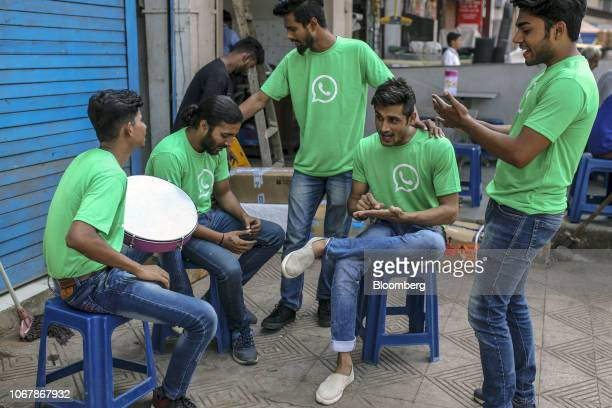 WhatsApp ambassadors rehearse during a roadshow for Facebook Inc's WhatsApp messaging service and Reliance Jio Infocomm Ltd's wireless network in...