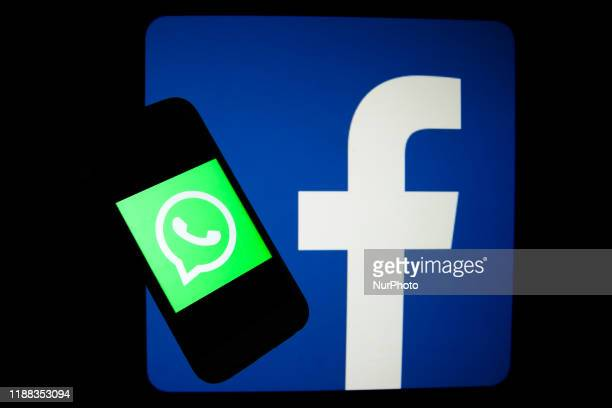 WhatsApp and Facebook logos are seen displayed on a screens in this illustration photo taken in Krakow Poland on December 9 2019