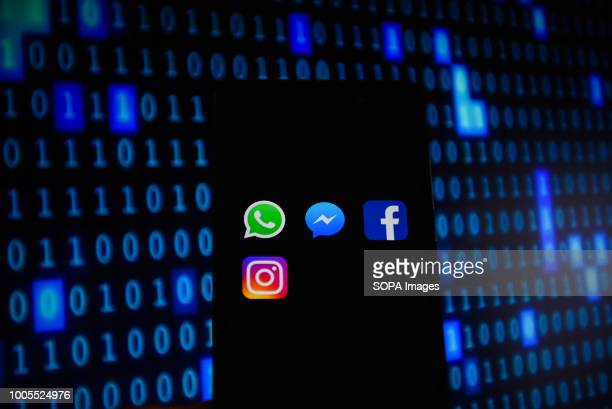 WhatsApp Facebook Instagram and Messenger logos are seen in an Android mobile device