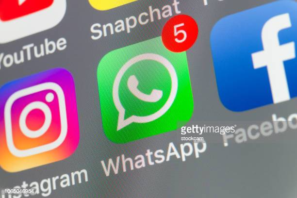 whatsapp, facebook, instagram and other cellphone apps on iphone screen - online messaging stock pictures, royalty-free photos & images