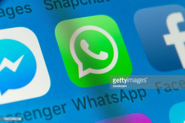 whatsapp, facebook, messenger and other cellphone apps on iphone screen - online messaging stock pictures, royalty-free photos & images