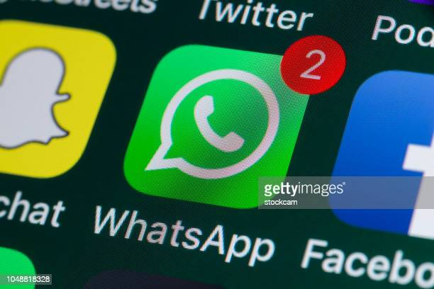 whatsapp, facebook, snapchat and other phone apps on iphone screen - twitter stock pictures, royalty-free photos & images