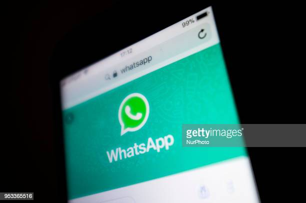 A Whatsapp Messenger logo is pictured ona mobile phone display London on May 1 2018 The chief executive and cofounder of WhatsApp the Facebookowned...