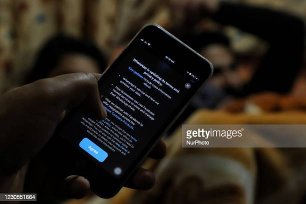 Whatsapp privacy policy terms message flashes on a mobile phone screen in Baramulla, Jammu and Kashmir India on 12 January 2021